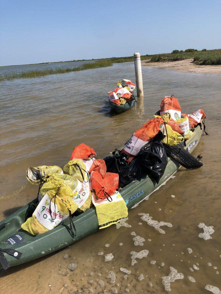 Ymca Group's Kayak Loads Of Trash
